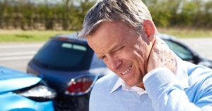 Man in pain from a car accident