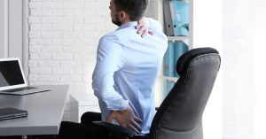 man with back pain from poor posture