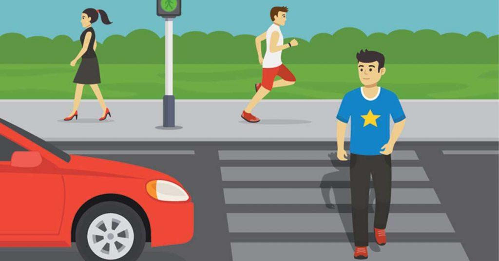 man crossing the road