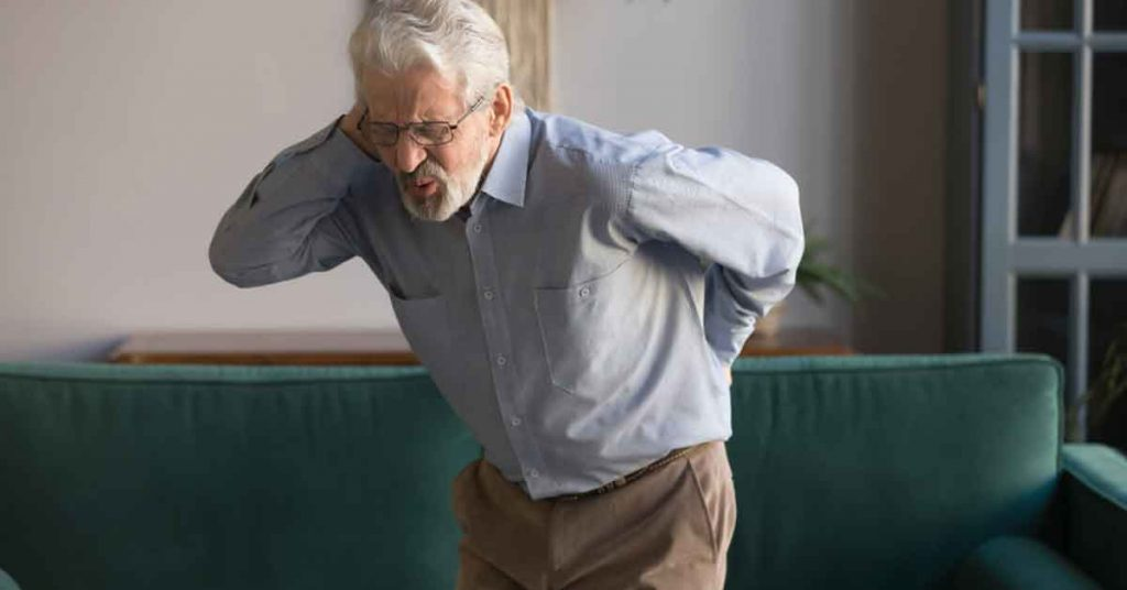 older man experiencing back and neck pain
